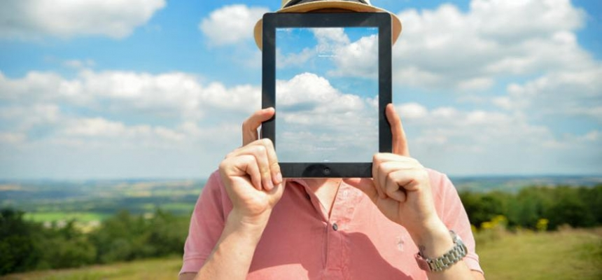 transparency person holding tablet clouds