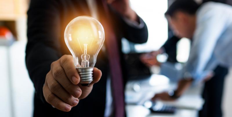 professional innovator holding lightbulb